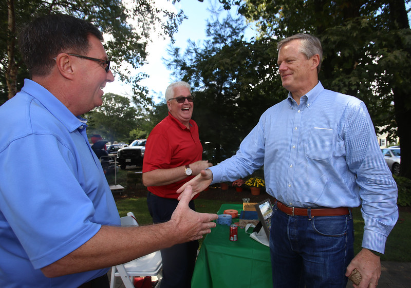 State Rep. Dave Nangle's annual steak and lobster fundraiser at Lenzi's. Dave Nangle greets Gov. Charlie Baker. At rear is Nangle's friend Bob Spinney of Lowell. (SUN/Julia Malakie)