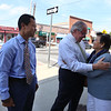 Massachusett House speaker Robert DeLeo meets State Rep. Rady Mom's mother Sarou Chea, during a visit to Lowell to endorse Mom for reelection in the primary, at a gathering of supporters in Cupples Square. (SUN/Julia Malakie)