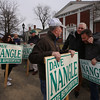 Supporters of State Rep. Dave Nangle hold signs at Andover and Nesmith Streets in Lowell at afternoon rush hour. Front left to right: early arrivers Bob McMahon of Lowell, his cousin Jack Spinney of Dracut, and son Brian McMahon of Lowell. (SUN/Julia Malakie)