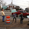 Supporters of State Rep. Dave Nangle including from left, Daniel Cancro, 9, his dad Robert Cancro of Lowell, sister Katherine, 13, a neighbor who did not wan to give name, mother Katie Cancro, and brother Robert, 14, hold signs at Andover and Nesmith Streets in Lowell at afternoon rush hour. (SUN/Julia Malakie)