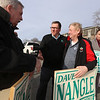State Rep. Dave Nangle thanks supporters  holding signs at Andover and Nesmith Streets in Lowell. From left, Nangle's cousin Phil Nangle of Lowell, Dave Nangle, his cousin George Nangle of Dracut, and former Lowell city councilor Corey Belanger. (SUN/Julia Malakie)