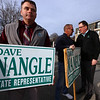 State Rep. Dave Nangle thanks supporters  holding signs at Andover and Nesmith Streets in Lowell. At left is former Lowell city councilor Corey Belanger. (SUN/Julia Malakie)