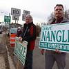 Supporters of State Rep. Dave Nangle, including his cousin George Nangle of Dracut, center, and former Lowell city councilor Corey Belanger, hold signs at Andover and Nesmith Streets in Lowell at afternoon rush hour. (SUN/Julia Malakie)