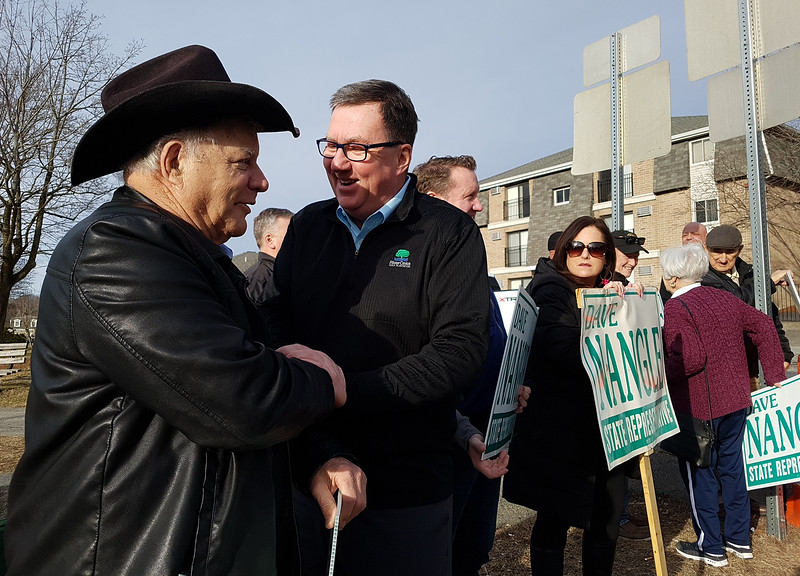 State Rep. Dave Nangle thanks supporters, including Jerry Largay of Lowell, left, holding signs at Andover and Nesmith Streets in Lowell. (SUN/Julia Malakie)
