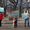Supporters of State Rep. Dave Nangle including Robert Cancro of Lowell, second from right, and his wife Katie, son Robert, 14, daughter Katherine, 13, and son Daniel Cancro, 9, hold signs at Andover and Nesmith Streets in Lowell at afternoon rush hour. (SUN/Julia Malakie)