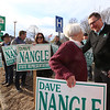 State Rep. Dave Nangle thanks supporters including Gloria Desmond of Lowell, center, holding signs at Andover and Nesmith Streets in Lowell. (SUN/Julia Malakie)