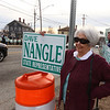 """Supporters of State Rep. Dave Nangle including Gloria Desmond of Lowell, hold signs at Andover and Nesmith Streets in Lowell at afternoon rush hour. Desmond said """"he's a good person really. He only hurt himself."""" (SUN/Julia Malakie)"""