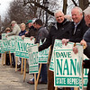 Supporters of State Rep. Dave Nangle signs at Andover and Nesmith Streets in Lowell at afternoon rush hour. (SUN/Julia Malakie)