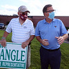 State Rep. Dave Nangle of Lowell, who faces two challengers in the Democratic primary, stands with supporters including Tom Scanlon of Lowell, left, holding signs on Clark Road behind Stadium Plaza.  (SUN/Julia Malakie)