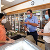 State Rep. Dave Nangle of Lowell, who faces two challengers in the Democratic primary, talks with Store 38 owner Meena Patel of Lowell, left.At right is Nangle's daughter Kellie Nangle. Patel has been in business for 30 years and said Nangle is her husband's best friend.  (SUN/Julia Malakie)