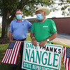 State Rep. Dave Nangle of Lowell, who faces two challengers in the Democratic primary, stands with supporters including Jerry Largay of Lowell, left, holding signs on Clark Road behind Stadium Plaza.  (SUN/Julia Malakie)