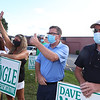State Rep. Dave Nangle of Lowell, who faces two challengers in the Democratic primary, stands with supporters including Charlotte Spinney and her daughter Kerry Spinney, left, and his brother Bill Nangle, right, all of Lowell, holding signs on Clark Road behind Stadium Plaza.  (SUN/Julia Malakie)