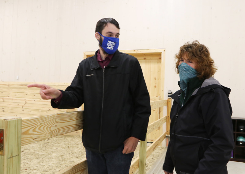 State Rep. Dave Robertson gets an impromptu tour of Strongwater Farm, a therapeutic riding center, from executive director Maria Antonioni. He helped them lease state land at Tewksbury State Hospital to build a new building for an indoor riding arena and offices. (SUN/Julia Malakie)