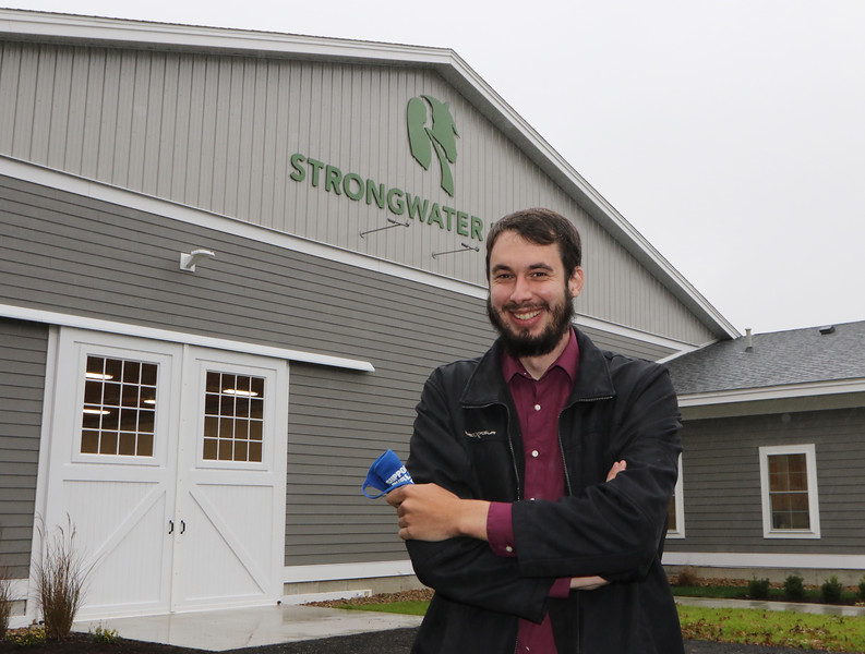 State Rep. Dave Robertson visits Strongwater Farm, a therapeutic riding center. He helped them lease state land at Tewksbury State Hospital to build a new building for an indoor riding arena and offices. (SUN/Julia Malakie)
