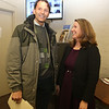 State Rep.-elect Tami Gouveia chats with Donald Van Dyne of Chelmsford at Chelmsford Town Hall. (SUN/Julia Malakie)