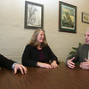 State Rep.-elect Tami Gouveia , D-Acton meets with Chelmsford assistant town manager Mike McCall, left, and town manager Paul Cohen. (SUN/Julia Malakie)