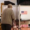 Penny Lambroukos of Tewksbury votes in town election, with her grandson Preston Silva, 4, of Boston, at the Tewksbury Senior Center. (SUN/Julia Malakie)