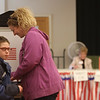 Sara Cohen of Tewksbury, with son Jared Cohen, 12, votes in town election at the Tewksbury Senior Center. (SUN/Julia Malakie)