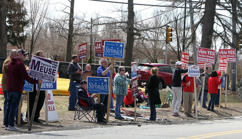 Signholders at Tewksbury Senior Center for town election. (SUN/Julia Malakie)