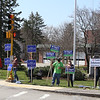 Signholders for Tewksbury town election at Main Street and Pleasant Street, outside Town Hall.  JULIA MALAKIE/LOWELLSUN