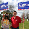 Tewksbury selectman and candidate for reelection Mark Kratman, holds a sign on Main Street in front of Town Hall, accompanied by his friend Kelly Slattery of Tewksbury.  JULIA MALAKIE/LOWELLSUN