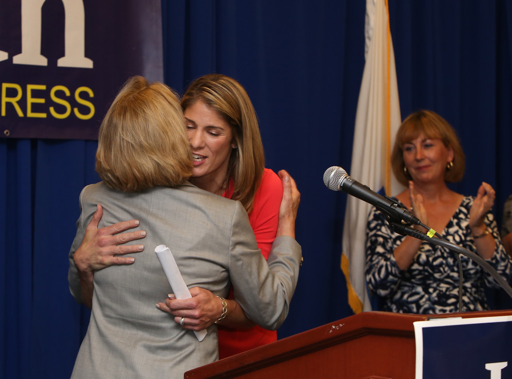 . Democractic congressional candidate Lori Trahan hosts unity event with former primary opponents, and U.S. Rep Niki Tsongas, a day after officially being delcared winner of the primary. From left, Niki Tsongas hugs Lori Trahan after introducing her to speak, as fellow primary candidate Barbara L\'Italien looks on. (SUN/Julia Malakie)