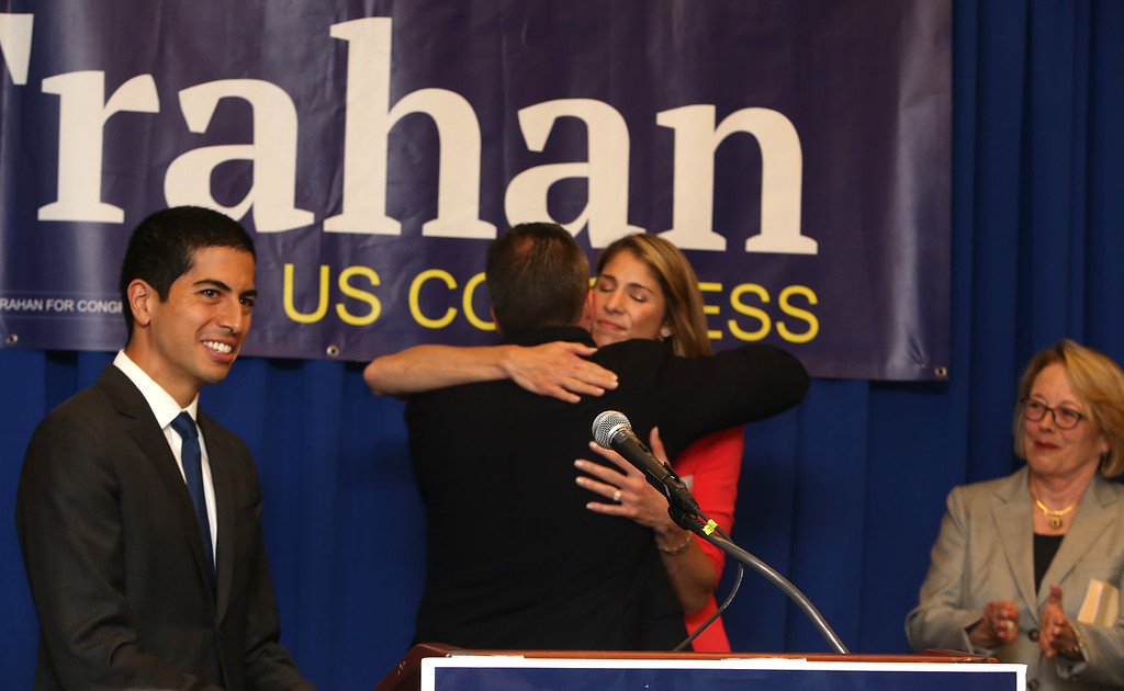 . Democractic congressional candidate Lori Trahan hosts unity event with former primary opponents, and U.S. Rep Niki Tsongas, a day after officially being delcared winner of the primary. From left, Dan Koh, Rufus Gifford hugging Lori Trahan after introducing Koh to speak, and Niki Tsongas. (SUN/Julia Malakie)