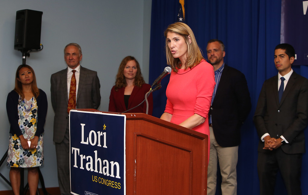 . Democractic congressional candidate Lori Trahan hosts unity event with former primary opponents, and U.S. Rep Niki Tsongas, a day after officially being delcared winner of the primary.  From left rear, Bopha Malone, Jeffrey Ballinger, Alexandra Chandler, Rufus Gifford and Dan Koh listen as Trahan speaks. (SUN/Julia Malakie)