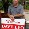 Signholders at the Elementary School for Tyngsboro town election. Dave Leo, write-in candidate for selectman. (SUN/Julia Malakie)