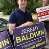 Signholders at the Elementary School for Tyngsboro town election. Jeremy Baldwin, candidate for Planning Board. (SUN/Julia Malakie)