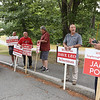 Signholders at the Elementary School for Tyngsboro town election. From left, Jeremy Baldwin, candidate for Planning Board, Dan Houston of Tyngsboro, Dave Robson of Tyngsboro, former selectman Warren Allgrove, selectman candidate Dave Leo, and Housing Authority candidate James Politi. (SUN/Julia Malakie)
