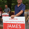 Signholders at the Elementary School for Tyngsboro town election. James Politi, write-in candidate for Housing Authority. (SUN/Julia Malakie)