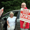 School Committee candidate Jeffrey Bowe, with his mother Vinette Bowe of North Andover, hold signs at the Elementary School for Tyngsboro town election.  (SUN/Julia Malakie)