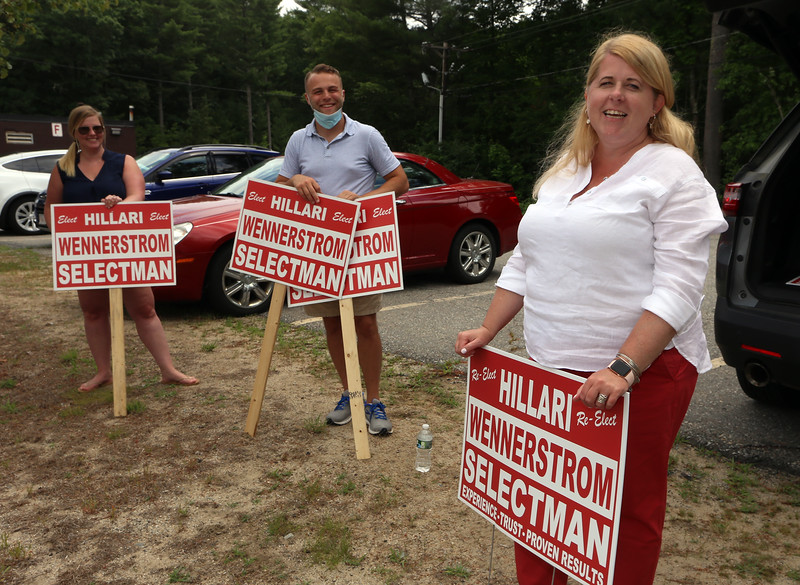 Signholders and voter check-in at the Middle School for Tyngsboro town election. From right to left, candidate Hillari Wennerstrom, with Matt Durkin and Jill Moulton.  (SUN/Julia Malakie)