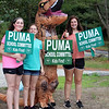 Signholders and voter check-in at the Middle School, and signholders at the Elementary School for Tyngsboro town election. From left, Olivia Lambert, 15, Katelyn Fugazzotto, 13, her sister Emily Fugazzotto, 14, in a dinosaur costume, and Samantha Puma, 15, daughter of the candidate. (SUN/Julia Malakie)