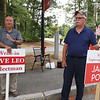 Signholders at the Elementary School for Tyngsboro town election. Selectman candidate Dave Leo, and Housing Authority candidate James Politi, both running write-in. (SUN/Julia Malakie)