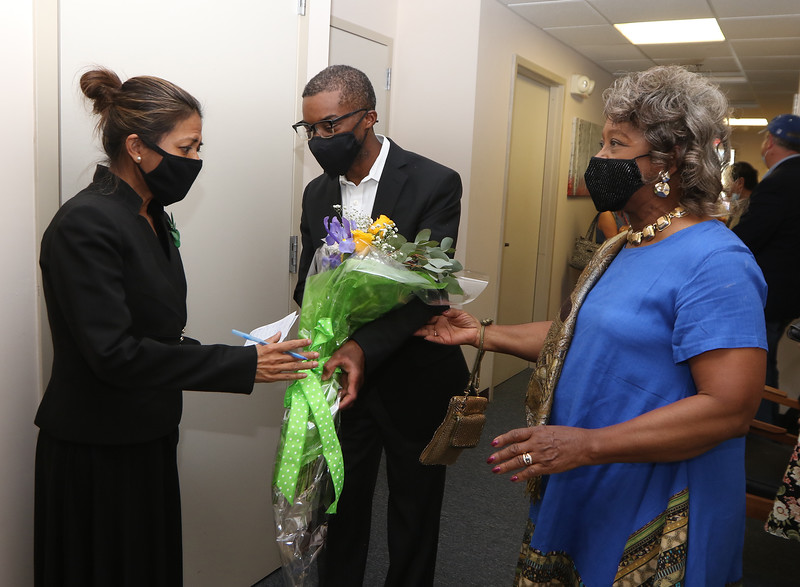 State Rep. Vanna Howard opens her new office at 25 Central Street in Lowell. From left, Vanna Howard, Brent Smith, and his mother Lura Smith, formerly of MCC, all of Lowell. JULIA MALAKIE/LOWELL SUN