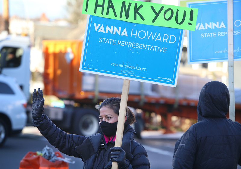 State Rep.-elect Vanna Howard and supporters stand at the corner of Andover and Nesmith Streets at morning rush hour to thank passersby. (SUN/Julia Malakie)