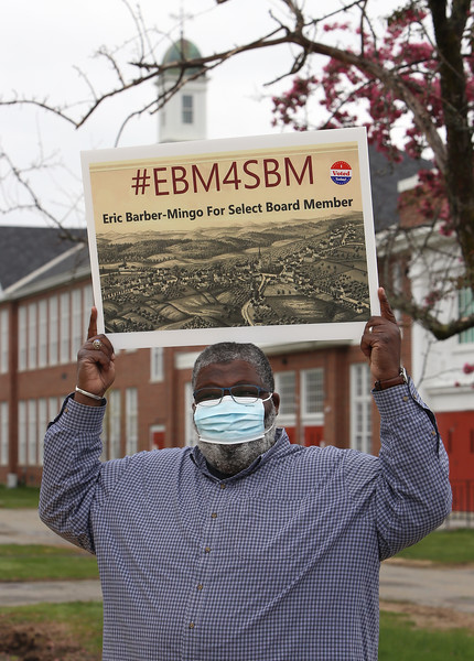 Westford town election, with contested races for Select Board and School Committee. Candidate for Select Board Eric Barber-Mingo holds his sign at the Abbot School. A history buff, he designed his own sign with a late 1800s view of Westford. JULIA MALAKIE/LOWELLSUN