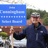 Westford town election, with contested races for Select Board and School Committee. Select Board candidate John Cunningham holds his sign at the Blanchard School. JULIA MALAKIE/LOWELLSUN