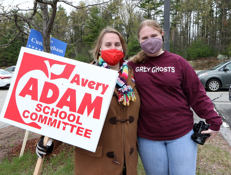 """Westford town election, with contested races for Select Board and School Committee. School Committee candidate for reelection Avery Adam, left, with her daughter Mackenzie Adam, 15, at the Miller School. Mackenzie, a freshman at Westford Academy, was covering the election for the school paper, The Ghost Writer, which said she could do it if she wasn't biased. Avery Adam joked that """"she's been cropping me out of the pictures."""" JULIA MALAKIE/LOWELLSUN"""