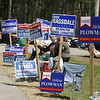 Sign holders for Wilmington School Committee candidates stand outside Town Hall during town election. JULIA MALAKIE/LOWELLSUN