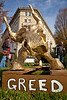 "Golden Bull / Golden Calf protest : Occupy DC protesters took their anti-corporate demonstration to Capitol Hill in Washington D.C. on December 15, 2011, carrying a ""golden bull"" to symbolize Congress' subservience to moneyed interests. The paper-mache bull was designed to look like the iconic Wall Street statue in New York's financial district, and is of course an allusion to the biblical ""Golden Calf"". The protest aimed to call attention to the worship of money by the US legislature and called for an end to the influence of big money in politics. Catholics United, an organization that professes to promote justice and the common good, first unveiled a symbolic golden calf at an Occupy Wall Street march in October. This day they joined with protesters at McPherson Square in hopes of delivering the calf to House Speaker John Boehner (R-OH). While they did not see the Speaker, they did deliver a petition to his office's outer door. (They were not allowed inside). Unfortunately, the Golden Bull could not enter the Raybourn House Office Building. He could not fit through the x-ray machine anyway."
