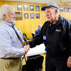 Don Knight | The Herald Bulletin<br /> Former Democratic County Chair Orvil Bud Wood congratulates Bill Savage as primary election results came in to Democratic Headquarters on Tuesday. Savage finished third in the Democratic primary and will be on the ballot for county council at-large in the fall.