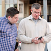 John P. Cleary | for The Herald Bulletin<br /> Republican County Council at Large candidate Alex Byers looks at the numbers with Middle District Commissioner candidate Steve Sumner on his phone Tuesday evening at Republican Headquarters.