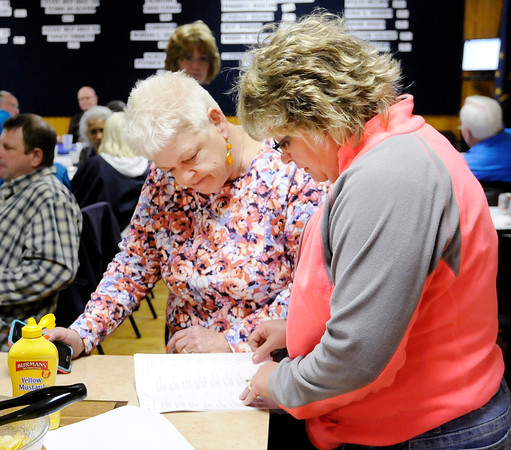 Don Knight | The Herald Bulletin<br /> Lisa Hobbs looks over election results with Madison County Democratic Party Chair Ludy Watkins at Democratic Party Headquarters on Tuesday. Hobbs will be on the democratic ticket for county council at-large in November.