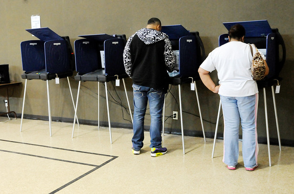Don Knight   The Herald Bulletin<br /> From left, Randy Nunn Jr. and his mother Rhonda Nunn cast their ballot at the Anderson Zion Baptist Family Life Center during the primary election on Tuesday.