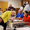 John P. Cleary | for The Herald Bulletin<br /> People were showing their id's and signing the poll books as they prepared to vote at the Fall Creek precincts in the Pendleton Community Building.