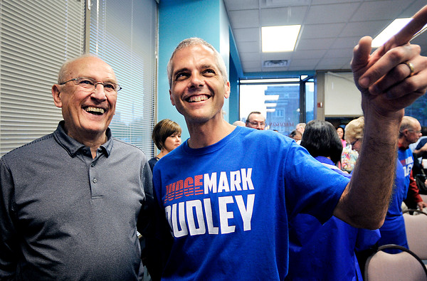 John P. Cleary | for The Herald Bulletin<br /> Incumbent Circuit Court 6 Judge Mark Dudley, right, points to the final vote count on the board to Bob Blume at Republican Headquarters after winning his primary race against Rodney Cummings.