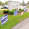 Don Knight | The Herald Bulletin<br /> Campaign signs line the driveway at Anderson Zion Baptist Church during the primary election on Tuesday. Four precincts from Anderson's fourth ward vote at the church's Family Life Center.